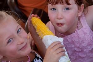 kids eating corn
